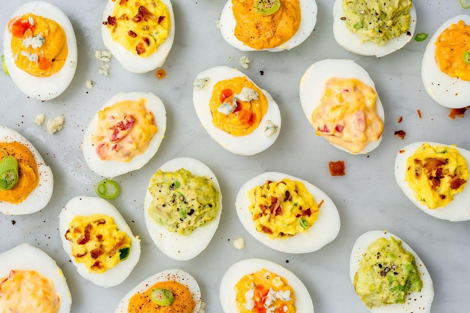 """<p>Easy, filling, and perfect at room temperature - nothing says cocktail party like some <a href=""""https://www.delish.com/cooking/g10/deviled-eggs/"""" rel=""""nofollow noopener"""" target=""""_blank"""" data-ylk=""""slk:deviled eggs"""" class=""""link rapid-noclick-resp"""">deviled eggs</a>! </p><p>Get the recipe from <a href=""""https://www.delish.com/cooking/recipe-ideas/a51851/classic-deviled-eggs-recipe/"""" rel=""""nofollow noopener"""" target=""""_blank"""" data-ylk=""""slk:Delish"""" class=""""link rapid-noclick-resp"""">Delish</a>.</p>"""