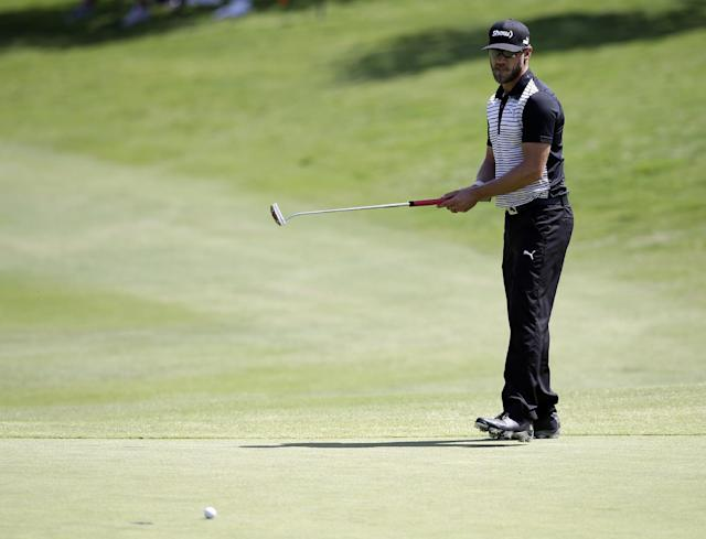 Graham DeLaet watches his putt go wide on the 16th green during the second round of the Byron Nelson Championship golf tournament, Friday, May 16, 2014, in Irving, Texas. (AP Photo/Tony Gutierrez)