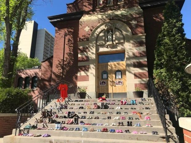 Dozens of pairs of children's shoes were recently placed on the steps of St. Paul's co-cathedral in downtown Saskatoon to honour the 215 children whose remains were found at a Catholic residential school site in Kampoops. Saskatchewan First Nations leaders are calling for Catholics to boycott Sunday mass until the church does what's right for survivors.