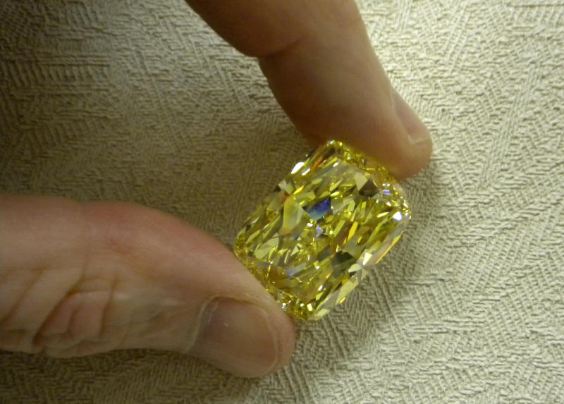 File--In this undated photo provided by the U.S. Marshals Service shows a large yellow diamond.  The large yellow diamond seized in a money laundering investigation in Ohio has gone on the auction block and quickly attracted an offer over the minimum starting bid of $900,000. The 43.51 carat diamond belonged to an Ohio businessman convicted of money laundering and conspiracy.  (AP Photo/U.S. Marshals Service, File)