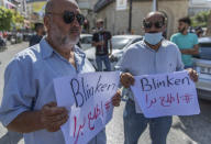 """Palestinians hold signs that read: """"Blinken, get out,"""" during a protest against the visit of U.S. Secretary of State Antony Blinken and meeting with Palestinian President Mahmoud Abbas, in the West Bank city of Ramallah, Tuesday, May 25, 2021. Blinken has vowed to """"rally international support"""" to aid Gaza during a visit to Israel at the start of a regional tour to shore up last week's cease-fire. (AP Photo/Nasser Nasser)"""