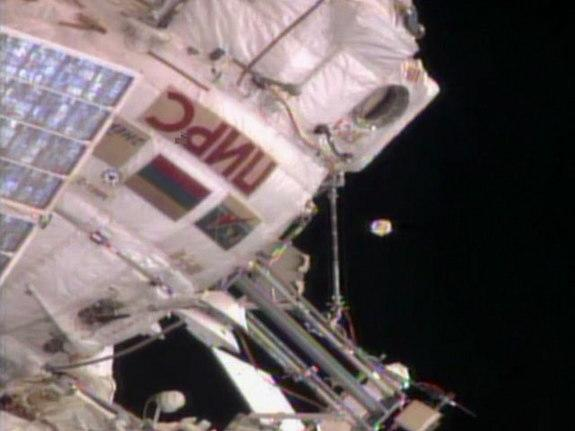 An unidentified object floats near the International Space Station on August 19, 2013. Russian ground controllers later identified it as an antenna cover from the Zvezda service module.
