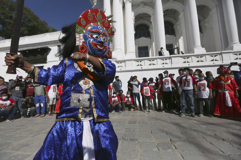 Masked dancers perform during the annual Indra Jatra festival in Kathmandu, Nepal, Sunday, Sept. 19, 2021. The feast of Indra Jatra marks the return of the festival season in the Himalayan nation two years after it was scaled down because the pandemic. (AP Photo/Niranjan Shrestha)