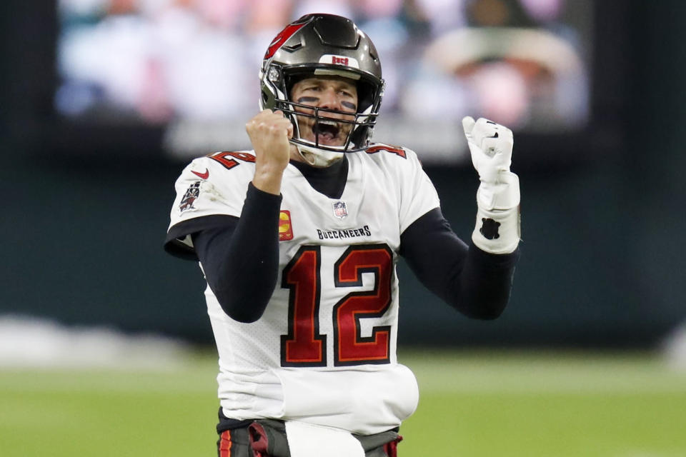 FILE - In this Sunday, Jan. 24, 2021, file photo, Tampa Bay Buccaneers quarterback Tom Brady reacts after winning the NFC championship NFL football game against the Green Bay Packers in Green Bay, Wis. The Super Bowl matchup features the most accomplished quarterback ever to play the game who is still thriving at age 43 in Brady against the young gun who is rewriting record books at age 25. (AP Photo/Matt Ludtke, File)