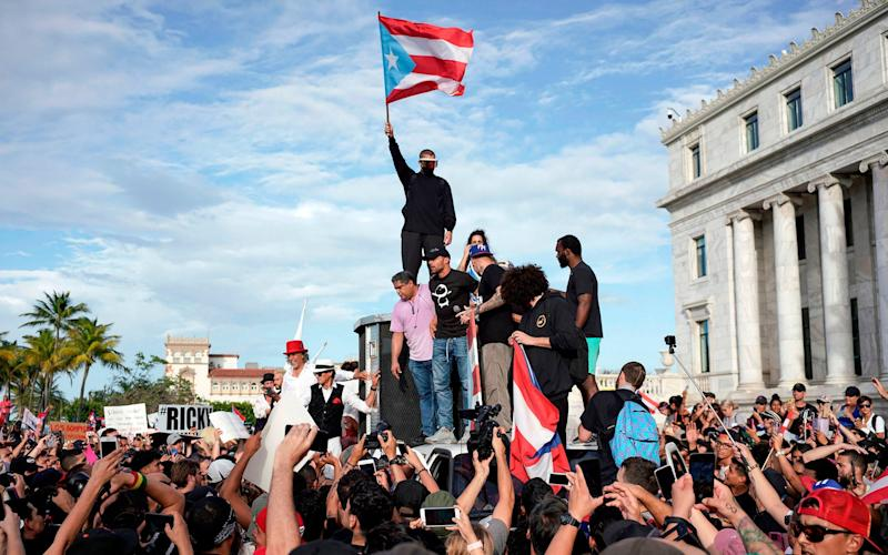 Puerto Rican singer Ricky Martin (centre) takes part in a demonstration demanding Governor Ricardo Rossello's resignation - AFP