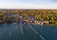 """<p>This picturesque village is located right on the edge of <a href=""""https://www.tripadvisor.com/Tourism-g48618-Skaneateles_Finger_Lakes_New_York-Vacations.html"""" rel=""""nofollow noopener"""" target=""""_blank"""" data-ylk=""""slk:Skaneateles Lake"""" class=""""link rapid-noclick-resp"""">Skaneateles Lake</a> in Upstate New York. With beautiful and serene surroundings, you can spend the days of summer relaxing in a kayak or hiking the trails. Plus, there are <a href=""""https://www.premiumoutlets.com/outlet/waterloo"""" rel=""""nofollow noopener"""" target=""""_blank"""" data-ylk=""""slk:premium shopping outlets"""" class=""""link rapid-noclick-resp"""">premium shopping outlets</a> not far from town.</p>"""