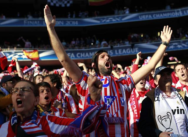Atletico supporters shout slogans, ahead of the Champions League final soccer match between Atletico Madrid and Real Madrid, at the Luz stadium, in Lisbon, Portugal, Saturday, May 24, 2014. (AP Photo/Francisco Seco)