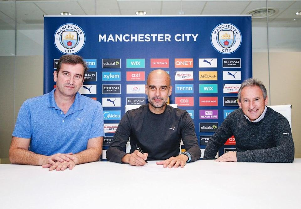 Manchester City manager Pep Guardiola signs a new contract (Manchester City FC via Getty Ima)