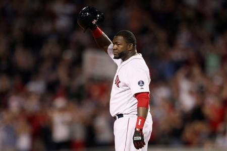 FILE PHOTO: Boston Red Sox's Ortiz stands safe at second base and salutes crowd after hitting 2000th career hit against Detroit Tigers during MLB American League Baseball game in Boston