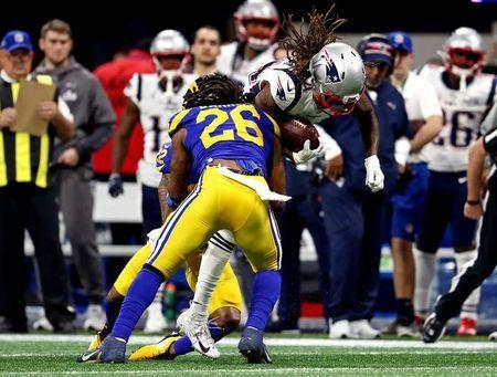 Feb 3, 2019; Atlanta, GA, USA; New England Patriots wide receiver Cordarrelle Patterson (84) runs the ball against Los Angeles Rams inside linebacker Mark Barron (26) during the second quarter in Super Bowl LIII at Mercedes-Benz Stadium. Mandatory Credit: Matthew Emmons-USA TODAY Sports