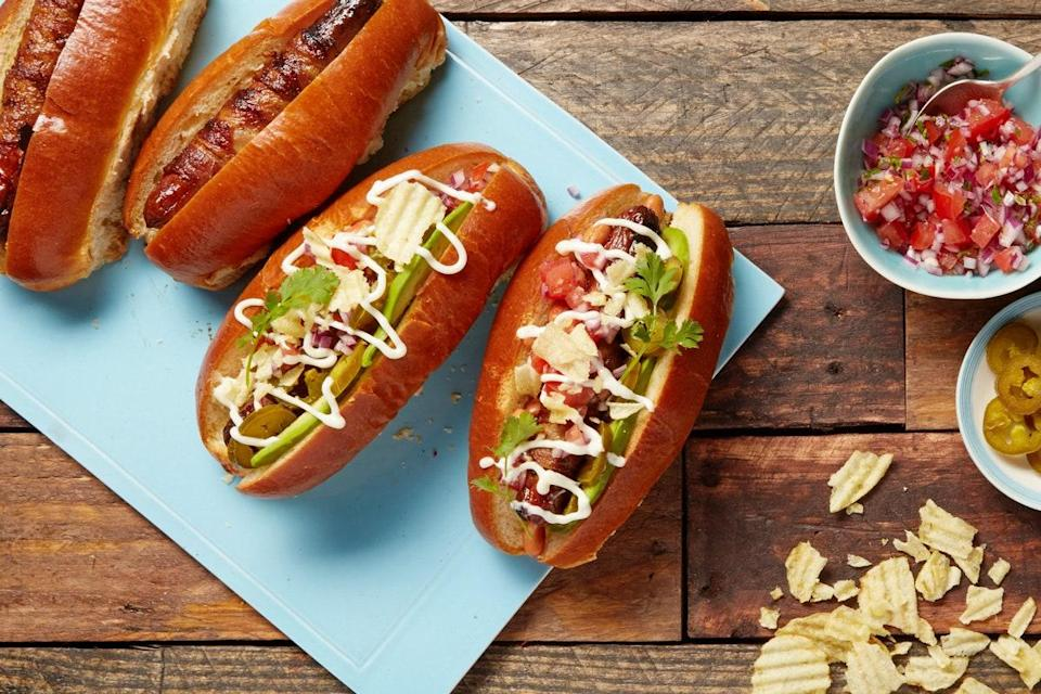 """When it comes to these Mexican-inspired hot dogs, more is more. The bacon adds smoky flavor, the mayo and pinto beans bring richness, and the salsa and pickled jalapeños provide a tangy, refreshing bite. <a href=""""https://www.epicurious.com/recipes/food/views/sonoran-hot-dogs-with-bacon-pico-de-gallo-and-avocado-56389617?mbid=synd_yahoo_rss"""" rel=""""nofollow noopener"""" target=""""_blank"""" data-ylk=""""slk:See recipe."""" class=""""link rapid-noclick-resp"""">See recipe.</a>"""