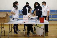 Medical personnel work at a temporary vaccination centre where vaccinations against the coronavirus disease (COVID-19) are administered, at a sports court in Tel Aviv