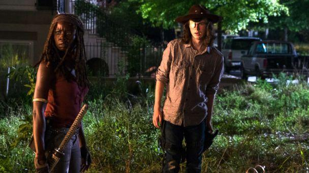 PHOTO: Chandler Riggs as Carl Grimes and Danai Gurira as Michonne in an episode from 'The Walking Dead.' (Gene Page/AMC)