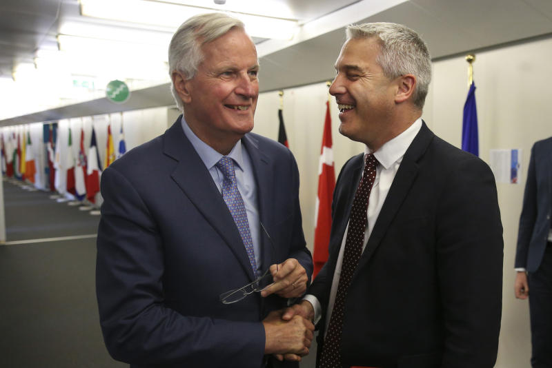 Britain's Brexit Secretary Stephen Barclay, right, shakes hands with European Union chief Brexit negotiator Michel Barnier before their meeting at the European Commission headquarters in Brussels, Tuesday, July 9, 2019. (Francois Walschaerts/Pool via AP)