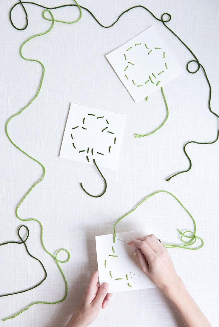 """<p>Keep your kids busy while you make the corned beef and cabbage with this fun project. It uses dull yarn needles so your little ones won't stick their fingers.</p><p><strong>Get the tutorial at <a href=""""https://sayyes.com/2016/03/diy-st-patricks-day-sewing-cards"""" rel=""""nofollow noopener"""" target=""""_blank"""" data-ylk=""""slk:Say Yes"""" class=""""link rapid-noclick-resp"""">Say Yes</a>.</strong></p><p><a class=""""link rapid-noclick-resp"""" href=""""https://www.amazon.com/yarn-needle/s?k=yarn+needle&tag=syn-yahoo-20&ascsubtag=%5Bartid%7C2164.g.35012898%5Bsrc%7Cyahoo-us"""" rel=""""nofollow noopener"""" target=""""_blank"""" data-ylk=""""slk:SHOP YARN NEEDLES"""">SHOP YARN NEEDLES</a><br></p>"""