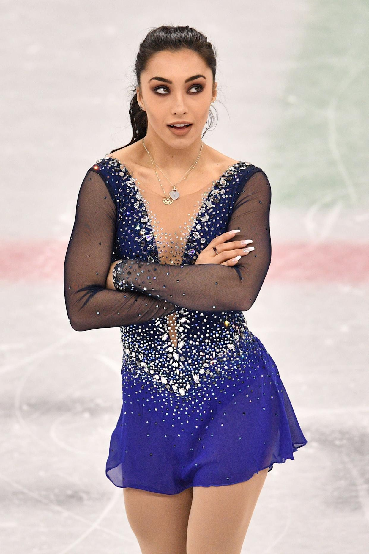 The Canadian skater's sparkly blue number, which she wore for her free skate during the single and team events, really was striking, but can we just take a minute to appreciate her full-on glam beauty look?
