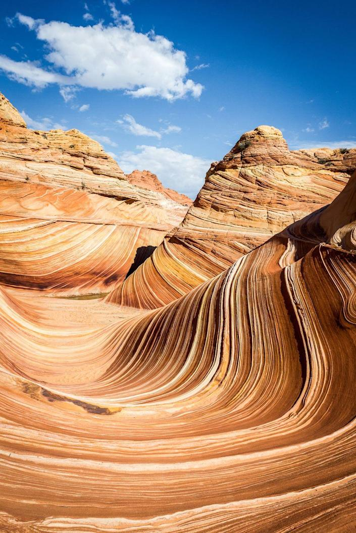 <p><strong>Where: </strong>The Wave, Arizona and Utah</p><p><strong>Why We Love It: </strong>Only 20 people per day are allowed to hike out to this Jurassic-age sandstone formation in the remote Paria Canyon-Vermilion Cliffs Wilderness, but all of the advance planning required to see this breathtaking place is totally worth it.</p>