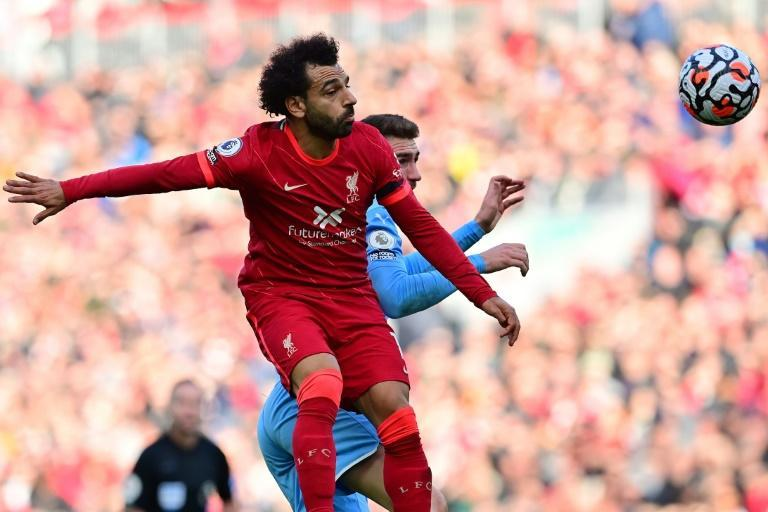 Egypt star Mohamed Salah (L) wins a heading duel during the Premier League draw between Liverpool and Manchester City at the weekend. (AFP/Paul ELLIS)