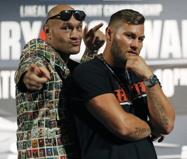 Tyson Fury, left, of England, and Tom Schwarz, of Germany, pose during a news conference for their upcoming fight Wednesday, June 12, 2019, in Las Vegas. ZZZ is scheduled to fight CCC in a heavyweight bout Saturday in Las Vegas. (AP Photo/John Locher)