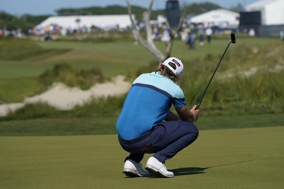 Cameron Smith, of Australia, reacts to a putt on the 11th hole during the first round of the PGA Championship golf tournament on the Ocean Course Thursday, May 20, 2021, in Kiawah Island, S.C. (AP Photo/Matt York)