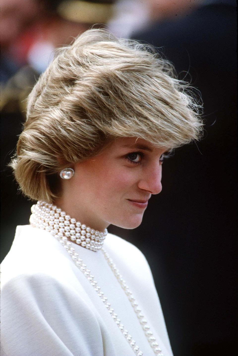 <p>It's hardly surprising that the nation seeks to imitate the Duchess of Cambridge's royal locks, as Princess Diana had a similar influence. Here, Diana teams heavy pearls with swept-back hair.<br><em>[Photo: PA]</em> </p>
