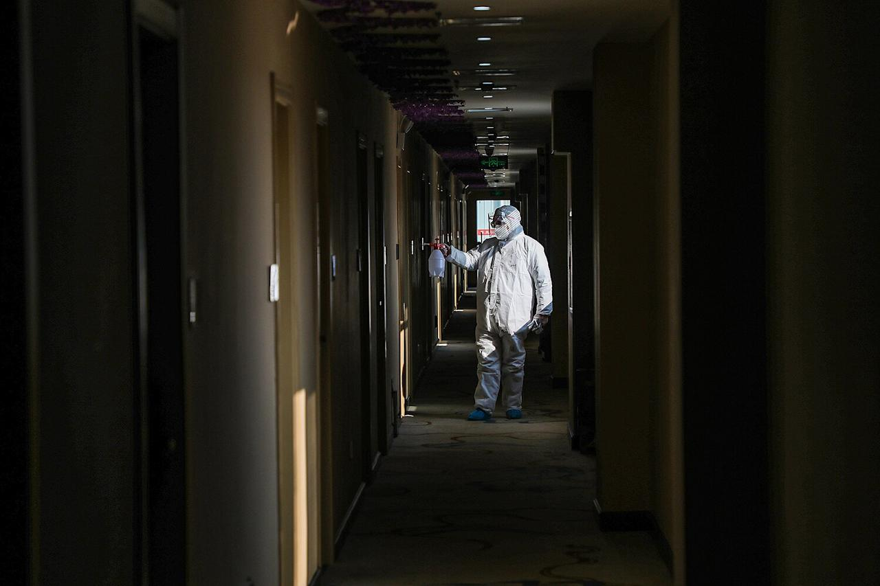 A medical staff member disinfects a quarantine zone converted from a hotel in Wuhan, China.