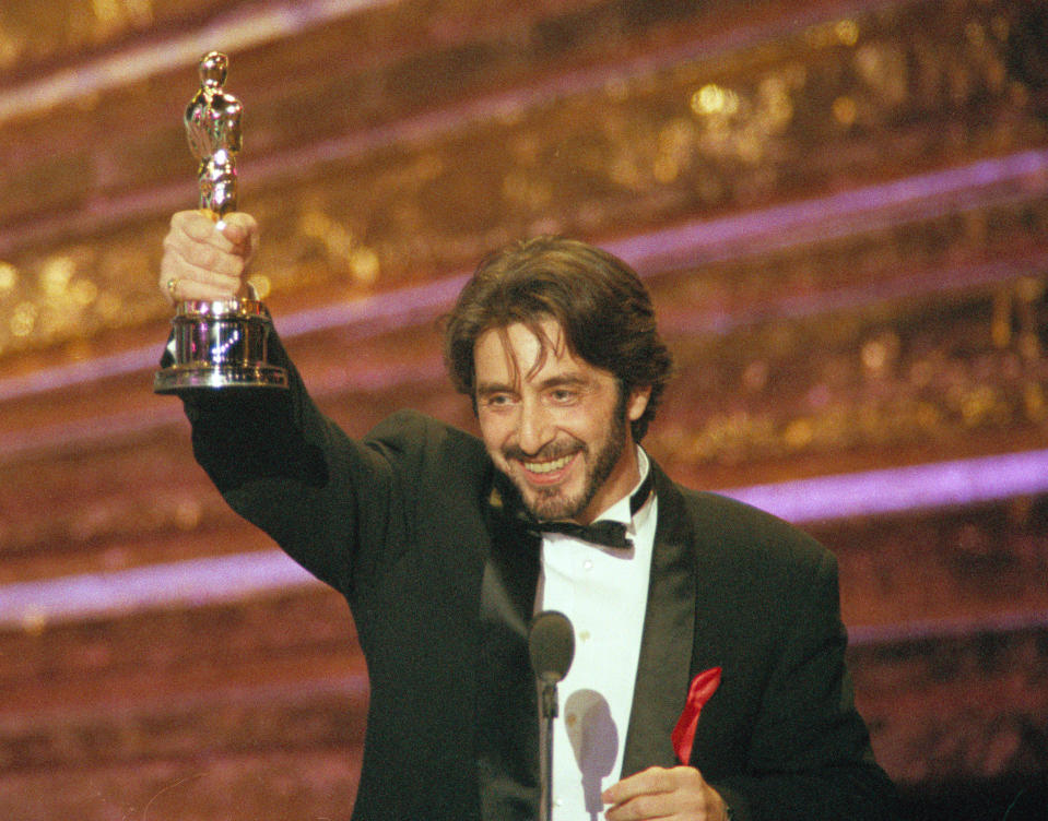"""Actor Al Pacino holds up the the Oscar he won as best actor for his role in """"Scent of a Woman,"""" at the 65th annual Academy Awards show in Los Angeles, Calif., on March 29, 1993.  (AP Photo/Bob Galbraith)"""