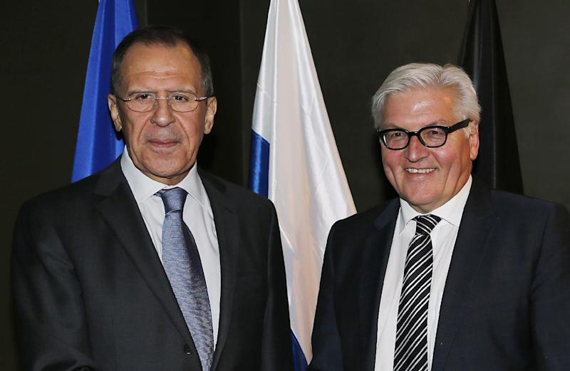 German Foreign Minister Frank-Walter Steinmeier , right, meets Russian Minister of Foreign Affairs, Sergey Lavrov, during the 50th Security Conference in Munich, Germany, Friday, Jan. 31, 2014. The conference on security policy takes place from Jan. 31, 2014 until Feb 2, 2014. (AP Photo/Frank Augstein)