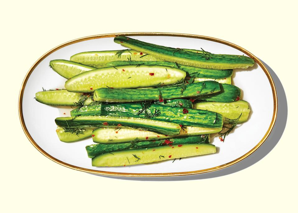 """What raw cucumbers lack in cheer, pickled cucumbers make up for in zip, zing, and crunch. The brine can work with any crunchy veg, but we like them best with cucumbers. We guarantee they'll be the sleeper hit of your next party spread. <a href=""""https://www.bonappetit.com/recipe/spicy-lightly-pickled-cucumbers?mbid=synd_yahoo_rss"""" rel=""""nofollow noopener"""" target=""""_blank"""" data-ylk=""""slk:See recipe."""" class=""""link rapid-noclick-resp"""">See recipe.</a>"""