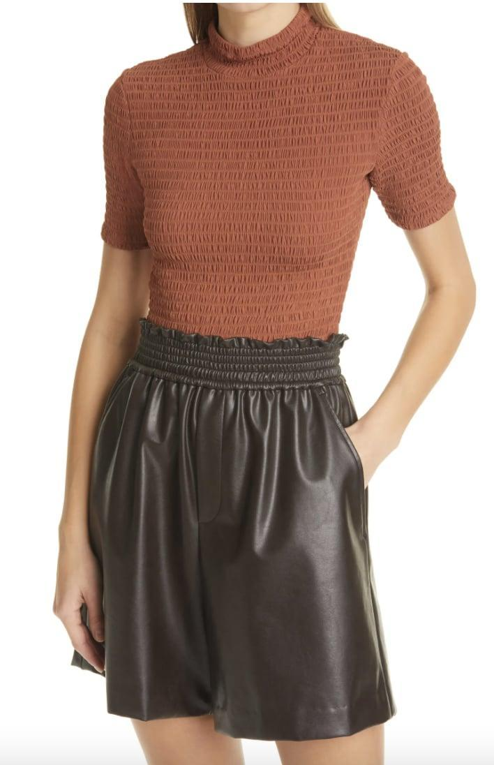 <p>The smocked silhouette of this <span>A.L.C. Dana Smocked Mock Neck Top </span> ($295) gives it a sexy feel.</p>