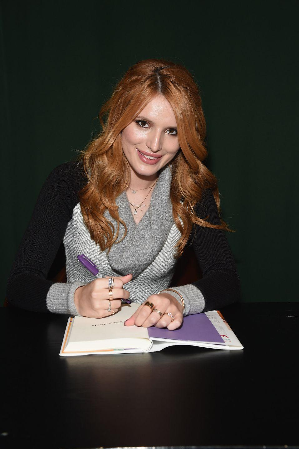 """<p>Venting in a journal is a classic way to deal with the traditional perils of high school (boys, friends, cliques). But the process ends up being anything but traditional for Autumn Falls, the title character in Bella Thorne's fantasy trilogy, when everything she writes in her father's old journal she wished would happen starts coming true. </p><p>The former Disney Channel star published the first book in the series in 2014 and followed it up with a sequel in 2015 and 2016. Bella told <em><a href=""""https://www.marieclaire.com/celebrity/news/a13814/bella-thorne-talks-famous-in-love-abc-family/"""" rel=""""nofollow noopener"""" target=""""_blank"""" data-ylk=""""slk:Marie Claire"""" class=""""link rapid-noclick-resp"""">Marie Claire</a></em> in 2017 that the message of the novels is to not be afraid of being who you are. """"You can't waste your time trying to be perfect because it's going to backfire,"""" she said. """"You have to trust yourself. That's really what the book is about.""""<br></p><p><a class=""""link rapid-noclick-resp"""" href=""""https://www.amazon.com/Autumn-Falls-Bella-Thorne/dp/038574434X?tag=syn-yahoo-20&ascsubtag=%5Bartid%7C2140.g.33987725%5Bsrc%7Cyahoo-us"""" rel=""""nofollow noopener"""" target=""""_blank"""" data-ylk=""""slk:Buy the Book"""">Buy the Book</a></p>"""