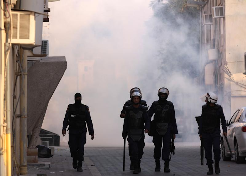 Riot police pull back after firing tear gas and stun grenades at a group of Bahraini women protesting against the government in Buri, Bahrain, southwest of the capital of Manama, on Wednesday, June 27, 2012. Prominent Bahraini human rights activist Zainab al-Khawaja was shot in the leg with a tear gas canister and taken to a hospital by another activist. (AP Photo/Hasan Jamali)