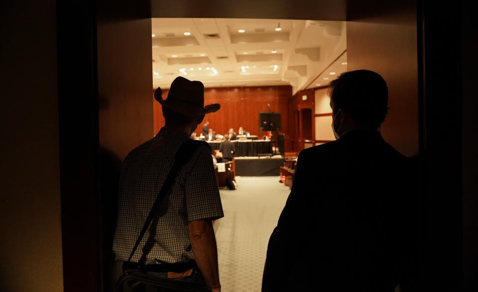 Witnesses enter a Texas State House committee hearing for an election bill at the Texas Capitol in Austin, Texas, Monday, Aug. 23, 2021. (AP Photo/Eric Gay)