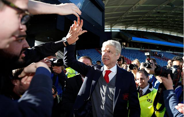 "Soccer Football - Premier League - Huddersfield Town vs Arsenal - John Smith's Stadium, Huddersfield, Britain - May 13, 2018 Arsenal manager Arsene Wenger waves to the fans at the end of the match Action Images via Reuters/Andrew Boyers EDITORIAL USE ONLY. No use with unauthorized audio, video, data, fixture lists, club/league logos or ""live"" services. Online in-match use limited to 75 images, no video emulation. No use in betting, games or single club/league/player publications. Please contact your account representative for further details."