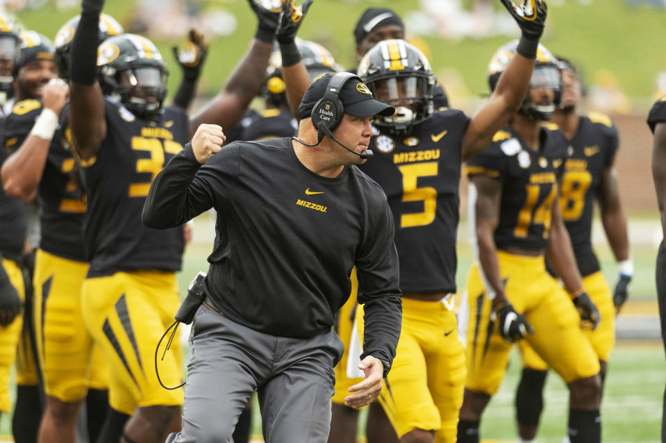 Missouri head coach Barry Odom pumps his fist as players celebrate after a reviewed call resulted in a Missouri touchdown during the first quarter of an NCAA college football game against South Carolina, Saturday, Sept. 21, 2019, in Columbia, Mo. (AP Photo/L.G. Patterson)