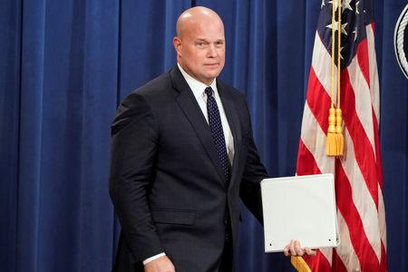 Acting U.S.Attorney General Matthew Whitaker arrives to address a news conference to announce indictments against China's Huawei Technologies Co Ltd in Washington.