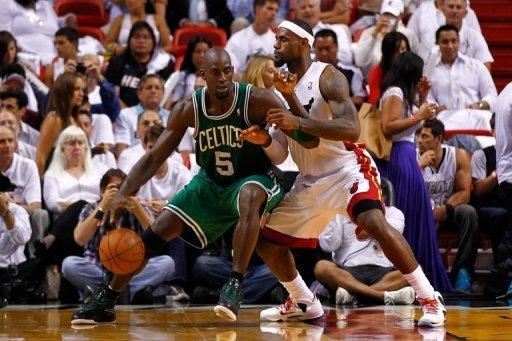 Boston Celtics' Kevin Garnett (L) and Miami Heat's LeBron James during game five of their NBA Eastern Conference finals on June 5. Boston and will advance with a home win in game six on Thursday