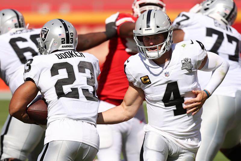 Derek Carr hands the ball off to Devontae Booker.