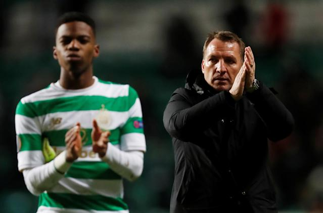 Soccer Football - Europa League Round of 32 First Leg - Celtic vs Zenit Saint Petersburg - Celtic Park, Glasgow, Britain - February 15, 2018 Celtic manager Brendan Rodgers and Charly Musonda applaud fans after the match REUTERS/Russell Cheyne