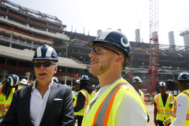 Los Angeles Rams owner Stan Kroenke, left, and wide receiver Cooper Kupp chat as they tour the team's new NFL football stadium Thursday, June 14, 2018, in Inglewood, Calif. McVay scrapped the final practice of minicamp and took his players and coaches on a tour of their multibillion-dollar stadium, which will open for the 2020 season. (AP Photo/Jae C. Hong)