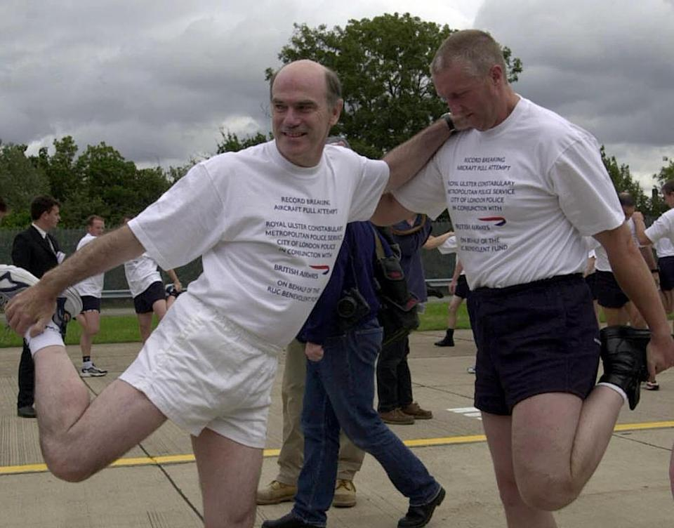 Sir Ronnie Flannagan, pictured (left) at a charity event in London in 2000, will vet requests for banned players to return to cricket. AFP Photo / Martin Hayhow (AFP Photo/)