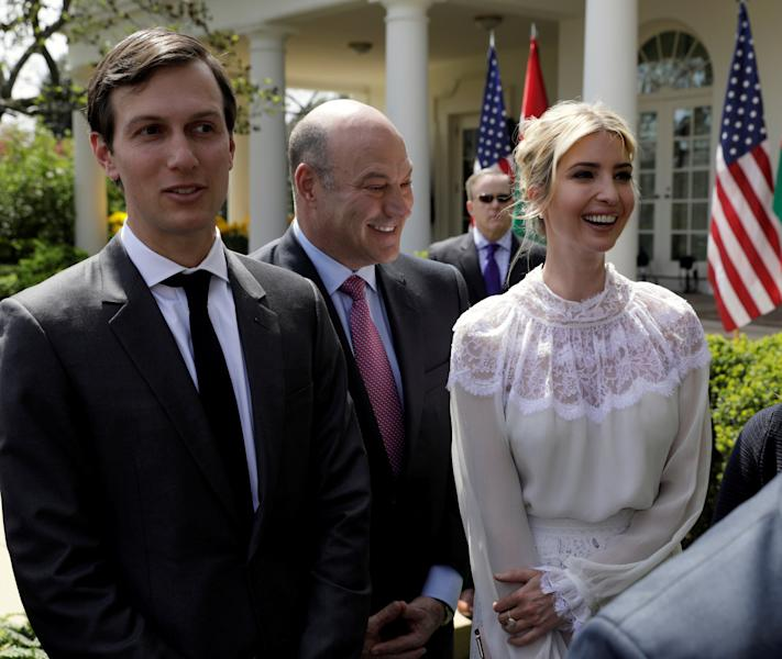 FILE PHOTO - Trump Senior Advisor Jared Kushner (L), his wife Ivanka Trump and with chief economic advisor Gary Cohn depart a news conference by U.S. President Donald Trump and King Abdullah of Jordan at the White House in Washington, U.S., April 5, 2017. REUTERS/Kevin Lamarque/File Photo