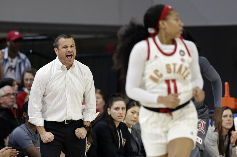 Louisville coach Jeff Walz yells during the first half of the team's NCAA college basketball game against North Carolina State in Raleigh, N.C., Thursday, Feb. 13, 2020. (AP Photo/Gerry Broome)