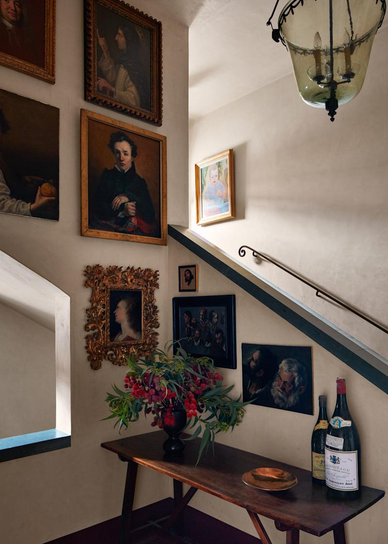 Some of the clients' vast art collection is displayed in the stairway.
