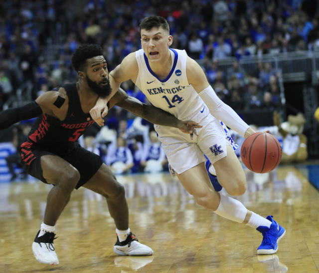<p>Kentucky's Tyler Herro (14) drives past Houston's Corey Davis Jr. during the first half of a men's NCAA tournament college basketball Midwest Regional semifinal game Friday, March 29, 2019, in Kansas City, Mo. (AP Photo/Orlin Wagner) </p>