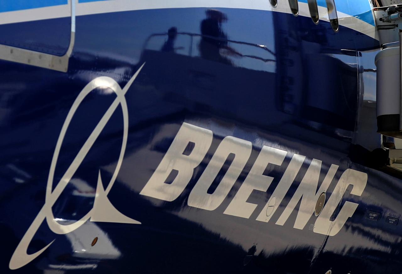 FILE PHOTO:    The Boeing logo is seen on a Boeing 787 Dreamliner airplane in Long Beach, California March 14, 2012. REUTERS/Lucy Nicholson/File Photo