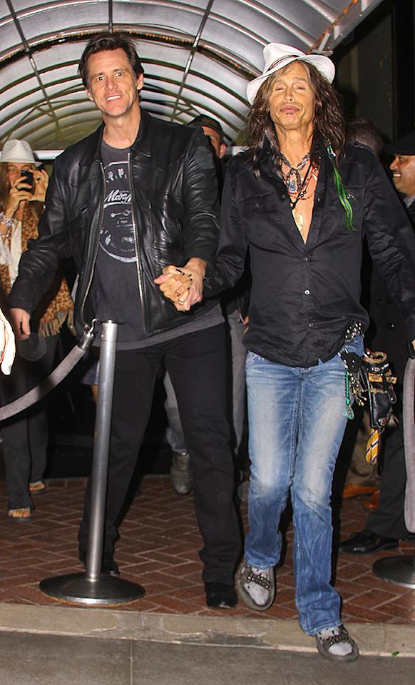 West Hollywood, CA - Funny man Jim Carrey and rock star Steven Tyler smile and hold hands as they leave Madeo's Restaurant in West Hollywood after having dinner together.