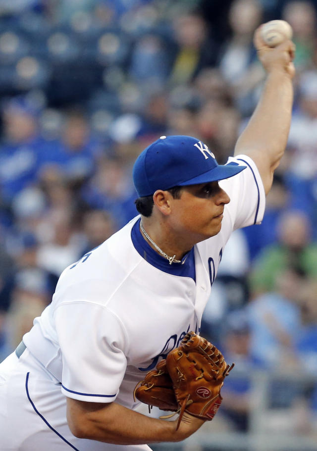 Kansas City Royals starting pitcher Jason Vargas delivers to a Minnesota Twins batter during the first inning of a baseball game at Kauffman Stadium in Kansas City, Mo., Friday, April 18, 2014. (AP Photo/Orlin Wagner)