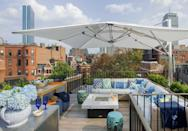 "<p>An umbrella is always a wise decision when your deck is in direct sunlight for the majority of the day. </p><p><em>Design by </em><a href=""http://designers.elledecor.com/interior-designers/kristin-paton-interiors"" rel=""nofollow noopener"" target=""_blank"" data-ylk=""slk:Kristin Paton Interiors"" class=""link rapid-noclick-resp""><em>Kristin Paton Interiors</em></a></p>"