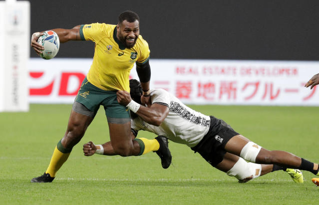 Australia's Samu Kerevi attempts to break a tackle during the Rugby World Cup Pool D game at Sapporo Dome between Australia and Fiji in Sapporo, Japan, Saturday, Sept. 21, 2019. (AP Photo/Aaron Favila)